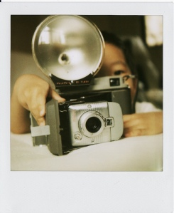 Son Holding Polaroid