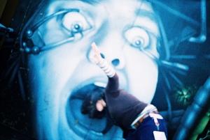 Lomo Girl Eaten by Graffiti in Brick Lane