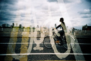 Bicycle Lane Road Sign Double Exposed with Cyclist